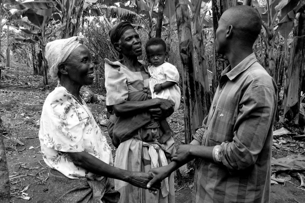 Uganda's Greeting Culture; notice the prolonged holding of hands into the conversation! - Uganda cultures and etiquette